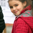 Little girl wearing red coat — Stock Photo