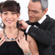 Man putting a necklace on his lover — Stock Photo #7548735