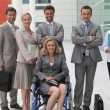 Woman in wheelchair with colleagues — Stock Photo #7548782
