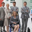 Woman in wheelchair with colleagues — Stock Photo