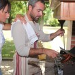 Man cooking on barbecue — Stock Photo