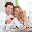 Happy couple eating meal at table — Stock Photo