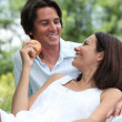 Happy couple relaxing in field — Stock Photo #7548967
