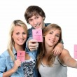 Foto Stock: Three teenagers with driving licences