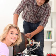 Couple repairing old television set — Stock Photo