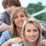 Three teenage friends sat on steps — Stock Photo #7549003