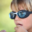 Nervous young boy wearing swimming goggles — Stock Photo #7549085
