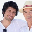 Two men with their arms around each other's shoulders — Stock Photo