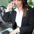 Businesswoman talking on the phone in the car — Stock Photo #7549161