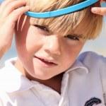 Boy with bucket on head — Stock Photo