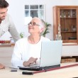 Elderly woman on laptop — Stock Photo
