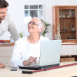 Elderly woman on laptop — Stock Photo #7549354