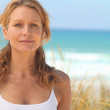 Woman on by the sea — Stock Photo