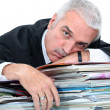 Man lying on paperwork — Stock Photo #7549441