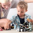 Mother and child playing with toy cars — Stock fotografie #7549570