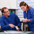 Plumber and female apprentice in office — Stock Photo #7549735
