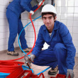 Stock Photo: Plumber and apprentice