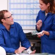 Electrician discussing parts in an office — Stock Photo #7549765