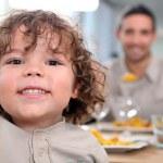 Little kid at kitchen table — Stock Photo #7549944