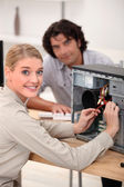 Portrait of a woman fixing a computer — Stock Photo