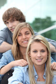 Three teenage friends sat on steps — Stock Photo