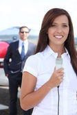 Journalist at airport — Stock Photo