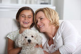 Mother, daughter and the dog — Стоковое фото