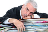 Man lying on paperwork — Stock Photo