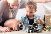 Mother and child playing with toy cars — Foto Stock