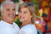 Two adults at funfair — Stock Photo