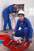 Plumber and apprentice — Stock Photo