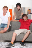 Housemates relaxing together in their sitting room — Stock Photo