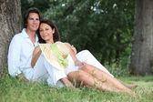 Couple lying on the grass together — Stock Photo