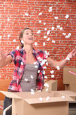 Woman throwing up packing peanuts — Stock Photo