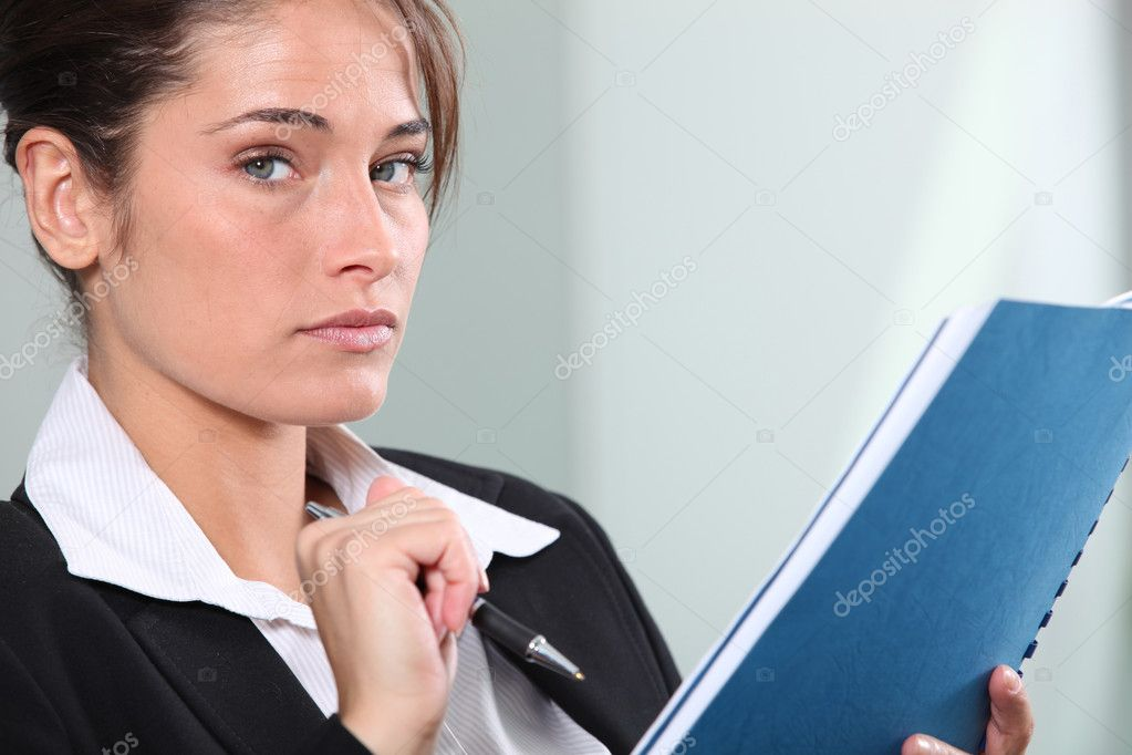 Serious young businesswoman making notes  Stock Photo #7549015