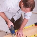 Man cutting wood with a jigsaw — Stock Photo #7550084