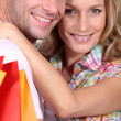 Couple holding shopping bags — Stock Photo