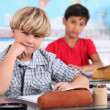 Schoolboys seated at desk in classroom — Stock Photo