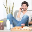 Stock Photo: Man eating breakfast at home