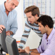 Stock Photo: Men connecting to Internet in classroom