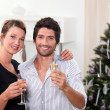 Young couple celebrating New Year's Eve — Stock Photo #7550682