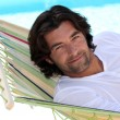 Man lying in a hammock — Stock Photo