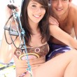 Portrait of a young man and a young woman in swimsuit — Stock Photo