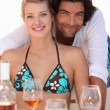 Stock Photo: Couple relaxing in beach restaurant