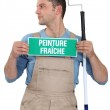 Man with a French wet paint sign — Stock Photo #7552032