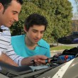 A father and son doing mechanic. - Stock Photo