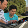 Stock Photo: Father and son doing mechanic.