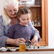 Little girl cooking with grandmother — Stock Photo #7552302