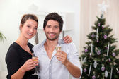 Young couple celebrating New Year's Eve — Stock Photo