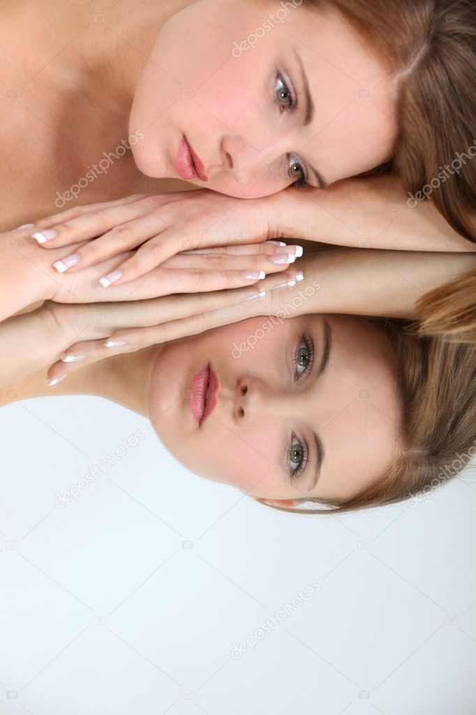Woman laying on mirror — Stock Photo #7551992
